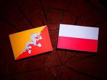 Bhutan flag with Polish flag on a tree stump isolated. Bhutan flag with Polish flag on a tree stump vector illustration