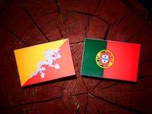 Bhutan flag with Portuguese flag on a tree stump isolated. Bhutan flag with Portuguese flag on a tree stump vector illustration