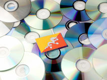 Bhutan flag on top of CD and DVD pile isolated on white. Bhutan flag on top of CD and DVD pile isolated Stock Image