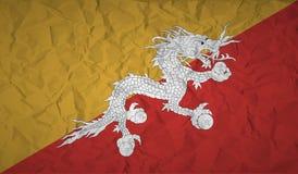 Bhutan flagga med effekten av skrynkligt papper vektor illustrationer