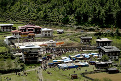 Bhutan, Haa,. Bhutan, crowd of people by traditional Tshechu in Karpho Lhakhang with funfair in Haa valley Stock Photo