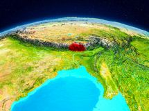 Bhutan from orbit. Satellite view of Bhutan highlighted in red on planet Earth. 3D illustration. Elements of this image furnished by NASA Stock Image