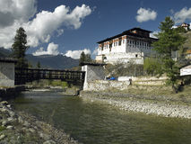 Bhutan - Paro Dzong - Buddhist Monastery. The cantilever bridge across the river to Rinpung Dzong (Buddhist Monastery)near the town of Paro in the Royalty Free Stock Photography