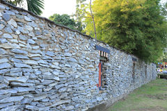 Bhutan style fence stone and decorated garden Royalty Free Stock Images