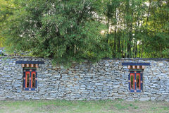 Bhutan style fence stone and decorated garden Stock Photo