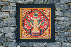 Bhutan style woodcraft on the rock wall Royalty Free Stock Photography