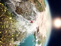Bhutan during sunrise. Highlighted in red on planet Earth with visible country borders. 3D illustration. Elements of this image furnished by NASA Royalty Free Stock Photos