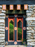Bhutan traditional wooden decoration in rock wall Stock Photo