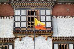 Bhutan, Trashigang,. Bhutan, Trashigang Dzong with national flag royalty free stock images