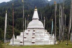 Bhutan, Trongsa. Bhutan, prayer flags and Chendibji Choerten, built in Nepalese style stock photos