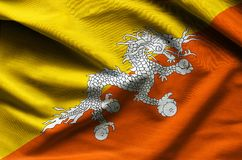 Bhutan waving flag. Close up fabric background Royalty Free Stock Photos