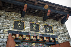 Bhutanese arts and religious carving at the entrance of National Memorial Chorten, Thimphu, Bhutan Stock Photo
