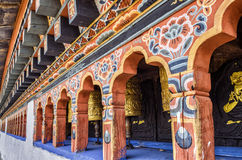 Bhutanese buddhism praying wheels at Chimi Lhakang Monastery, Punakha, Bhutan. Chimi Lhakhang, also known as Chime Lhakhang or Monastery or temple, is a Buddhist Royalty Free Stock Images