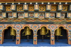 Bhutanese buddism praying wheels at Chimi Lhakang Monastery, Punakha, Bhutan. Chimi Lhakhang, also known as Chime Lhakhang or Monastery or temple, is a Buddhist Stock Image