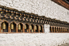 Bhutanese buddism praying wheels at Kyichu Lhakhang Temple, Paro, Bhutan. Also known as Kyerchu Temple or Lho Kyerchu is an important Himalayan Buddhist temple Stock Photo