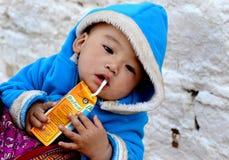 Bhutanese Child. A bhutanee kid drinking a cold drinks Stock Photo
