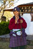 A Bhutanese holds his prayer heads and , Nepal. A friendly Bhutanese holds his prayer heads and salute with another hand in Buddhist way, Bhutan stock photos