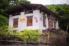Bhutanese house with traditional phallus paintings near Punakha, Bhutan. Royalty Free Stock Photo