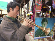 Bhutanese man - Paro - Bhutan. Pilgrim at the market at Paro Tsechu (religious festival) in The Kingdom of Bhutan in the Land of the Thunder Dragon high in the Stock Images
