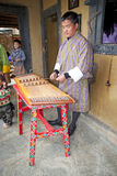 Bhutanese musician is playing a yangqin, Bhutan Royalty Free Stock Image
