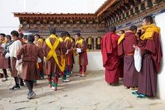 Bhutanese people and Buddhist monks at the Gangtey Monastery, Gangteng, Bhutan Stock Photo