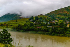 Bhutanese village near the river at Punakha, Bhutan Stock Photos