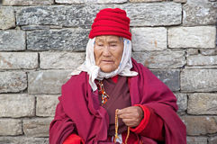 Bhutanese woman at the Memorial Chorten, Thimphu, Bhutan. Royalty Free Stock Images