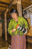 Bhutanese woman serving ara Royalty Free Stock Photography