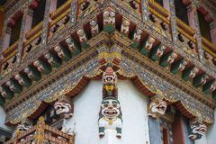 Bhutanese wooden carving cornice of monastery , snow lions , Bhutan. Elaborate wooden cornice of Buddhist Goemba , Bhutanese are highly skilled at carving royalty free stock photos