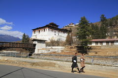 Bhutanese young man in traditional clothes walk on the street Royalty Free Stock Images