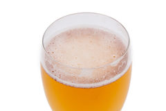 Bière blonde dans un verre Photo libre de droits