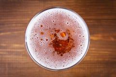 Bière en verre Mousse de bière Photos stock