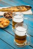 Bière et poissons Image stock