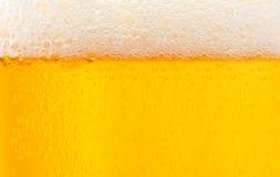 Bière texturisée avec la mousse Photos stock