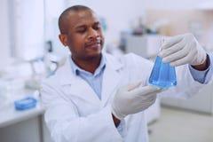 Biólogo alegre que guarda seu tubo imagem de stock royalty free