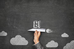 BI concept on blackboard with paper plane Stock Photos