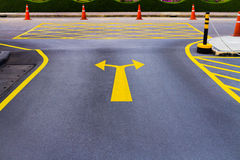 A bi-directional arrow symbol on road Royalty Free Stock Image