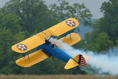 Bi-plane Flying Sideways. Stearman bi-plane flying sideways stock photo