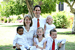 Bi-racial Family. Nicely dressed inter-racial family portrait royalty free stock image