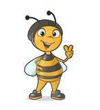 Bi som gör en gest segertecknet Arkivfoton