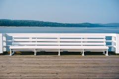 Biała ławka na molu Obraz Royalty Free