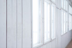 Biała drewniana ściana z starymi okno Obraz Stock