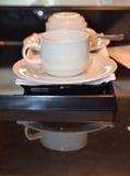 Biała filiżanka i spodeczek projektujący w rocznika retro stylu Zdjęcia Stock