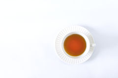 Biała filiżanki herbata na białym tle Zdjęcia Royalty Free