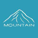 Biała halna ikona na błękitnym bachground Obrazy Royalty Free