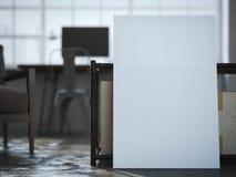 Biała kanwa blisko stołu w loft wnętrzu Obrazy Stock