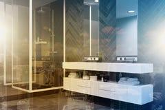 Biała zlew bezcelowości jednostka w czarnej łazience tonującej Zdjęcia Stock