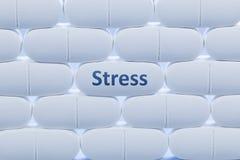 Białe pigułki z słowa ` stresu ` fotografia royalty free