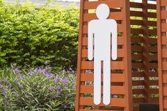 Białego człowieka ` s toaletowy symbol, pasiasty tło Obrazy Stock