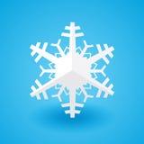 Białego papieru bożych narodzeń płatek śniegu na błękitnym tle z cieniem Zdjęcie Stock